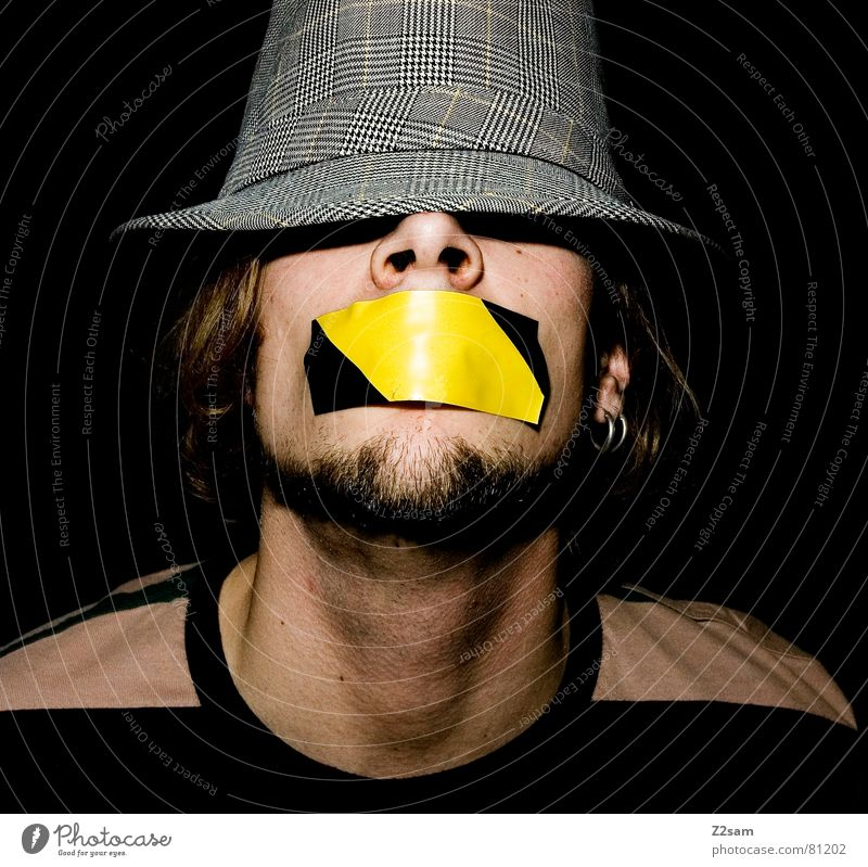 quiet please! Shackled Gagged Adhesive tape Stick Human being Stripe Facial hair Style Gray Yellow Closed eyes Man has mouth to portraite Mouth Face Hat