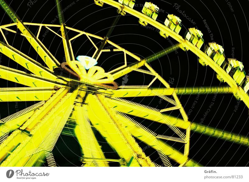 always beautiful in a circle Ferris wheel Fairs & Carnivals Night Yellow Light Long exposure Shooting match Neon light Lomography Oktoberfest funfair