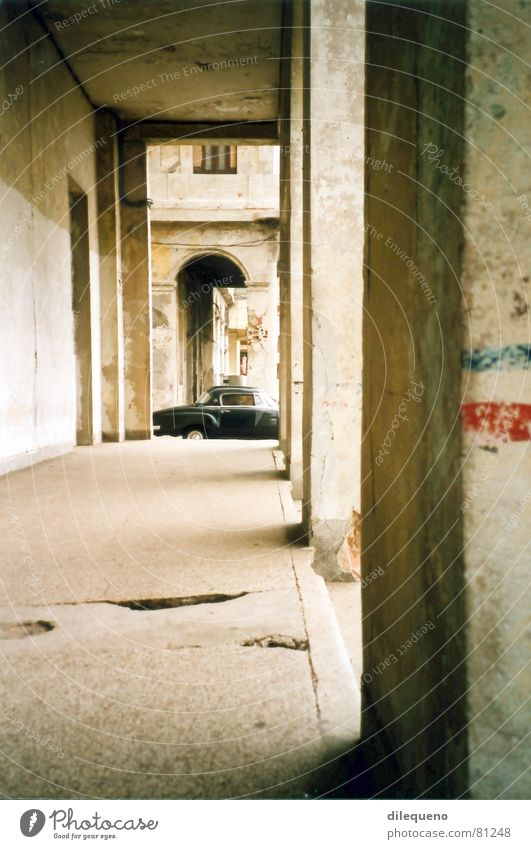 vintage car Havana Cuba Arcade Motor vehicle Car Foyer Carriage Traffic infrastructure black olditmer black car Column Corridor