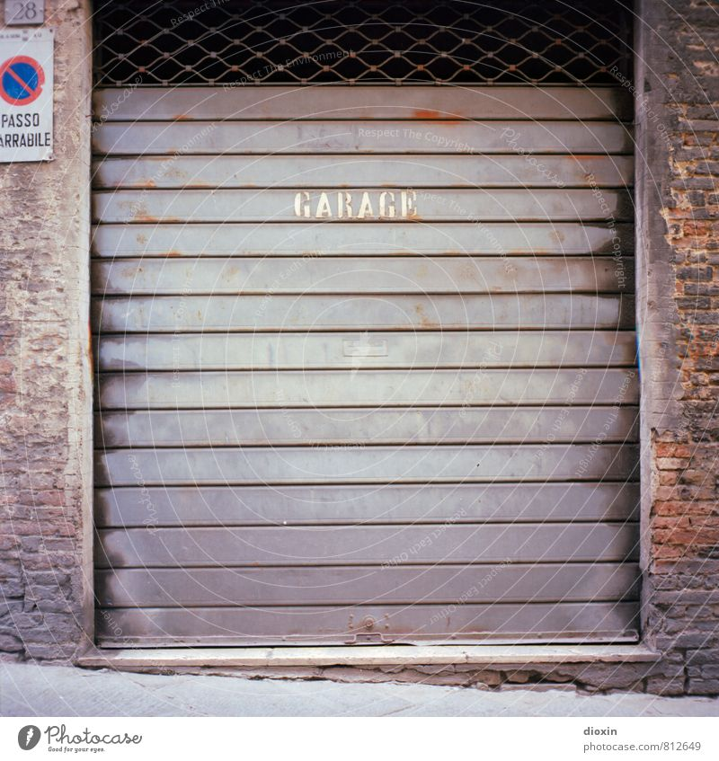 garage Siena Italy Wall (barrier) Wall (building) Garage Garage door Rolling door Brick wall Road sign Clearway Stone Metal Characters Town Analog Medium format
