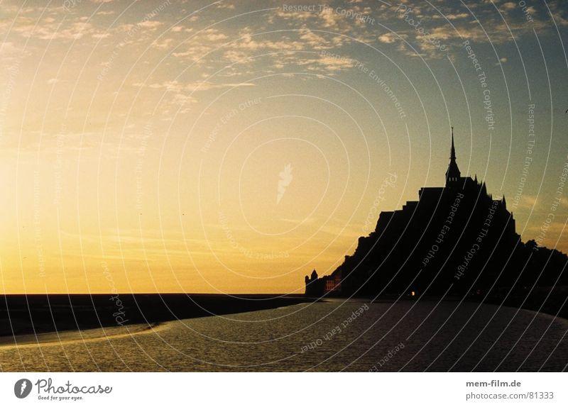 fairy tale island France Brittany Tide Ocean Sunset Evening sun Sea level Twilight Fairy tale Mont St Michel Normandie Landmark Monument Beach Coast Island