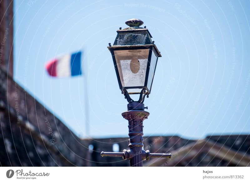French flag with street lamp Wind France Town Downtown Old town House (Residential Structure) Sign Flag Blue Red White Pride Politics and state Street lighting