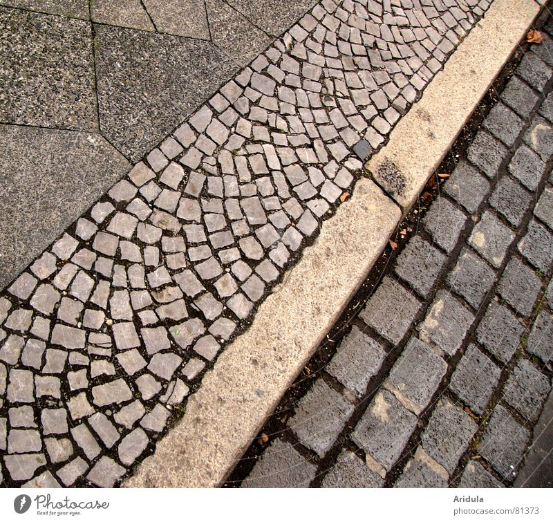 City Black Street Gray Stone Lanes & trails Going Walking Arrangement To go for a walk Floor covering Sidewalk Traffic infrastructure Cobblestones Pavement Paving stone