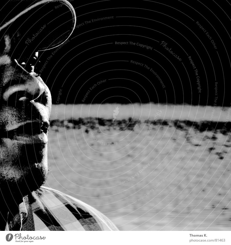 Human being Man Water Black Gray Mouth Lighting Waves Africa Image Shirt Cap Pond Character Gentleman Shaft of light