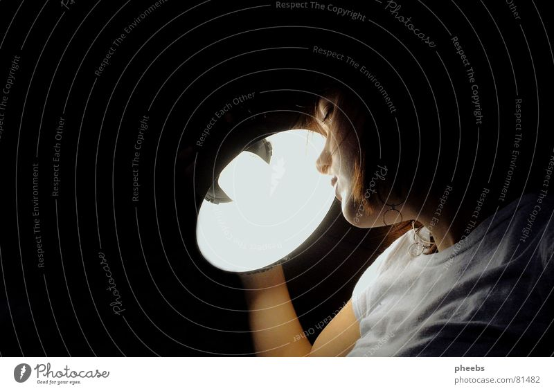 Woman Youth (Young adults) Face Black Lamp Gray Bright Lighting Arm Nose To hold on Wrinkles Flashy Awareness
