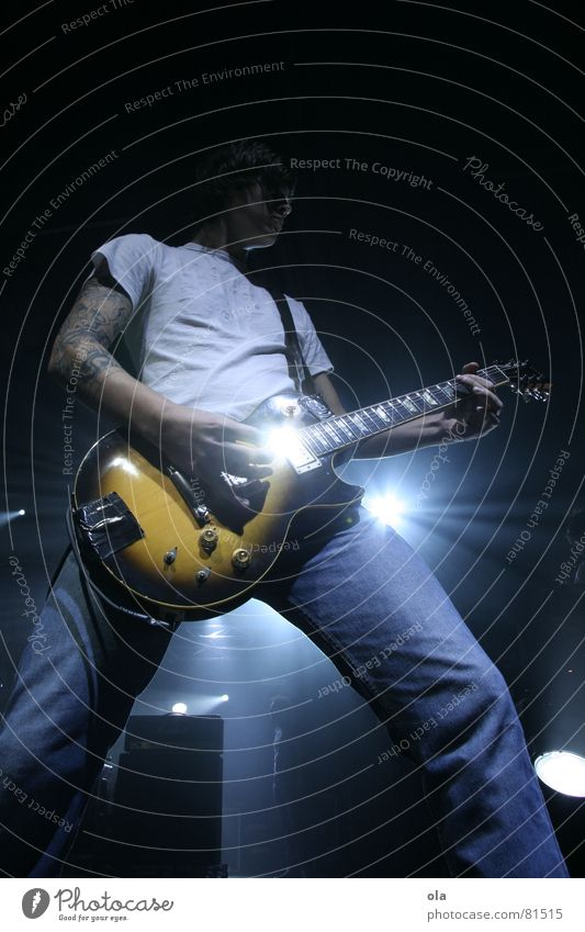 Man Blue Playing Music Bright Lighting Masculine Stand Jeans Part Concert Band Rock music Stage Guitar Tattoo