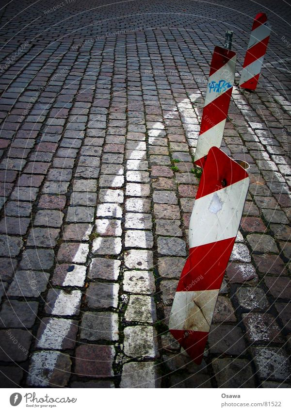 somewhere in Moabit Red Striped Diagonal Across Traffic lane Cobblestones Line Signage Traffic infrastructure Signs and labeling Street Crazy Lanes & trails