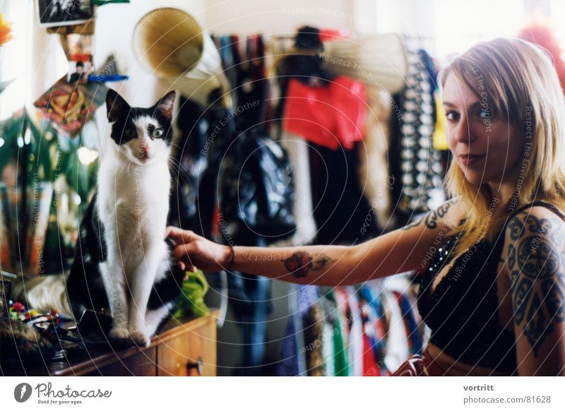 Woman Human being Cat Beautiful Blonde Perspective Clothing Dress Things Lady Argument Young woman Tattoo Snapshot Concepts &  Topics Punk