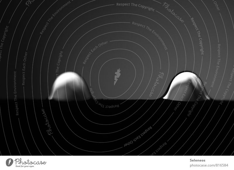 an island with two mountains Environment Nature Water Drops of water Rain Fluid Near Wet Natural Pure Black & white photo Interior shot Close-up Detail