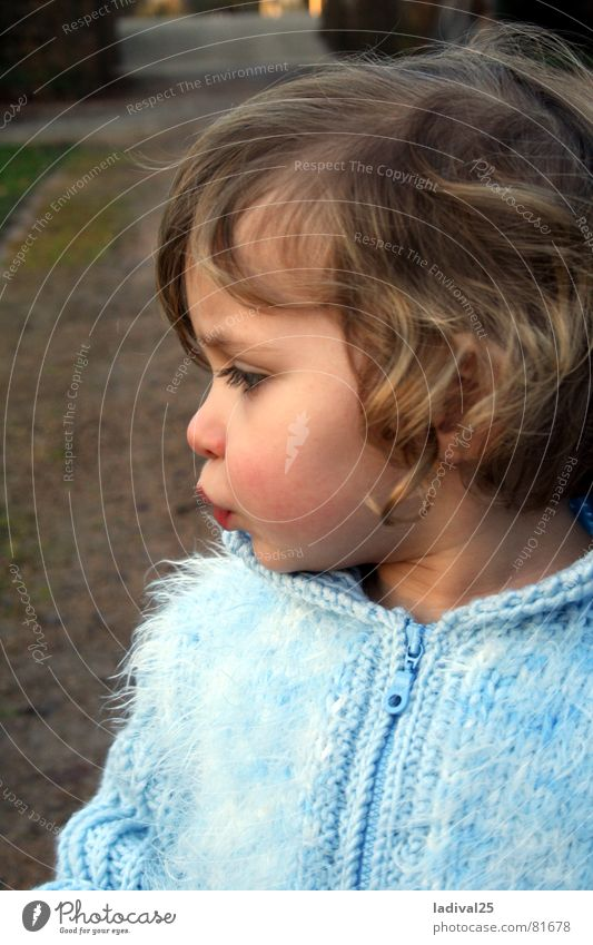 snooze princess Colour photo Exterior shot Evening Profile Looking Downward Child Toddler Mouth Lips Jacket Coat Curl Small Blue Diminutive Child to be baptized
