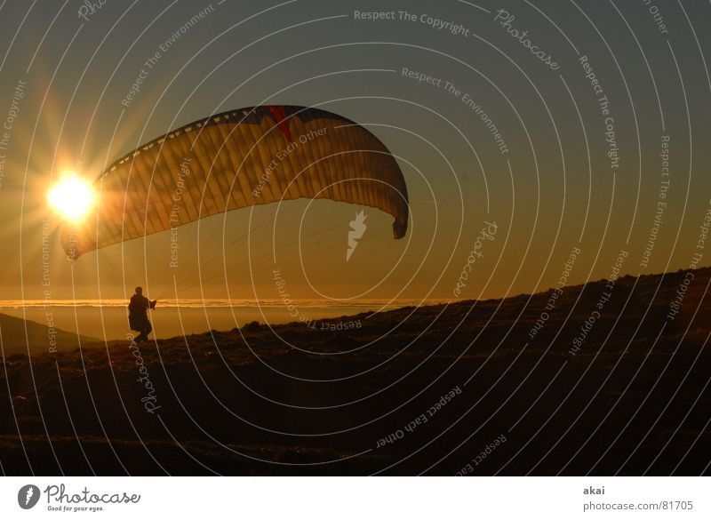 Paraglider at Schauinsland Paragliding Play of colours Sky blue Romance Sunlight Sunbeam Sunset Departure Homey Evening Twilight Bronze Emotions Puppy love