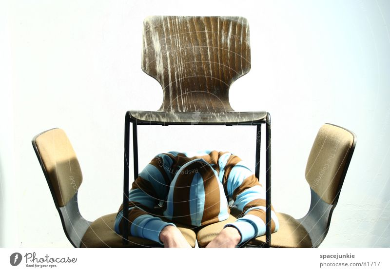 Between all chairs Hooded sweater Under Chair Hand Hiding place Office work Man Sweater Whimsical Proverb Strange Figure of speech Backrest Write Seating