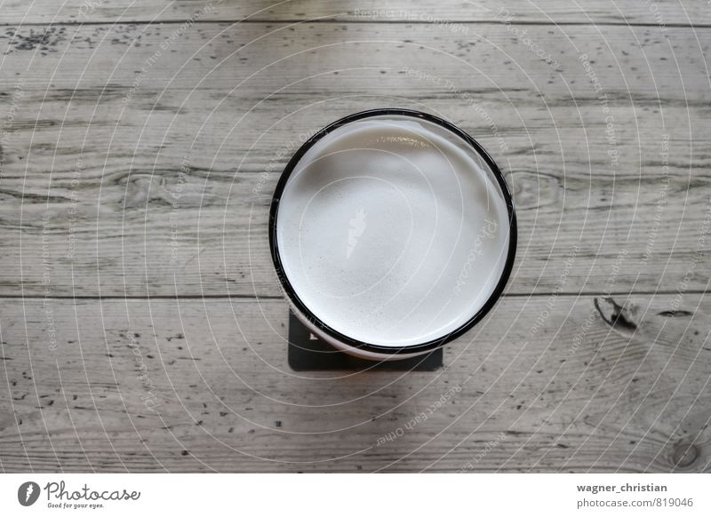 Beer glass on wooden table Beverage Cold drink Authentic Cool (slang) Fluid Debauchery Glass Table Wooden table Bright Colour photo Detail Deserted
