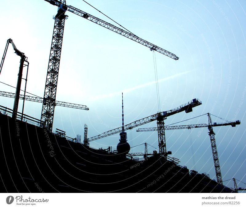 ruffled with cranes Man's work Crane Sky Construction site Steel Concrete Black Dark Work and employment Crane operator Berlin Construction steel Craft (trade)