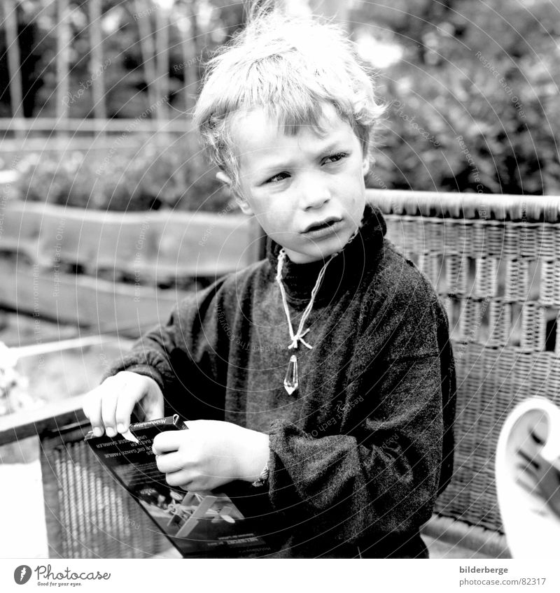 observantly Rock crystal Retreat Child Gift Pensive Watchfulness Grasp Dreamily Portrait photograph Gray Black Boy (child) Skeptical Testing & Control Hippie