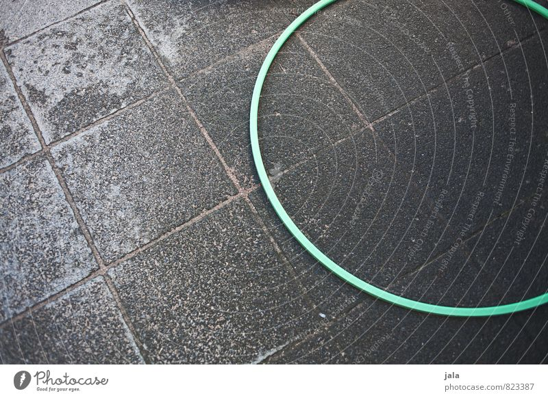 hoop Hula hoop Places Paving stone Lie Good Gloomy Leisure and hobbies Colour photo Exterior shot Copy Space left Copy Space right Neutral Background Day