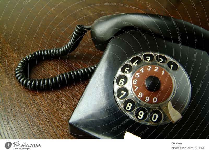 Phone Telephone Telecommunications Rotary dial Deutsche Telekom Select Digits and numbers Wood Wooden table Black Receiver Connection Gadget Contact