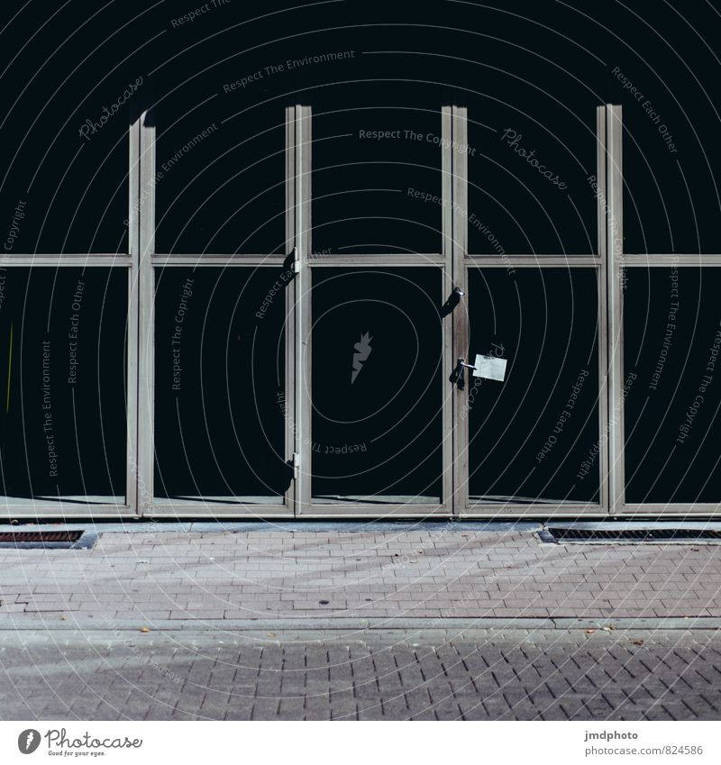 Black windows Small Town Downtown Pedestrian precinct Deserted Window Door Shop window Industrial construction Window pane Glazed facade Stone Glass Metal Steel