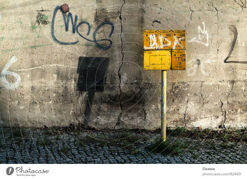 Yellow Street Wall (building) Grass Graffiti Signs and labeling Concrete Energy industry Sidewalk Signage Gas Crack & Rip & Tear Pole Rod Column Electronic