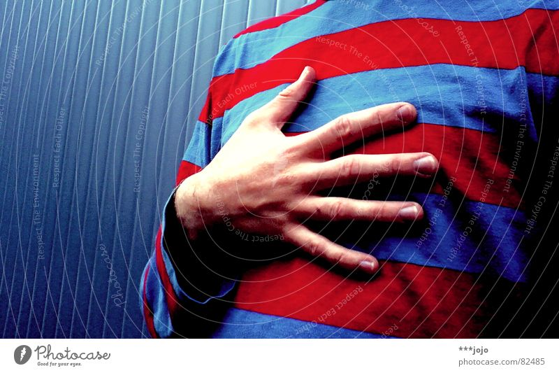 Human being Man Youth (Young adults) Hand Blue Red Colour Style Religion and faith Heart Fingers Clothing Stripe T-shirt Swimming pool Chest