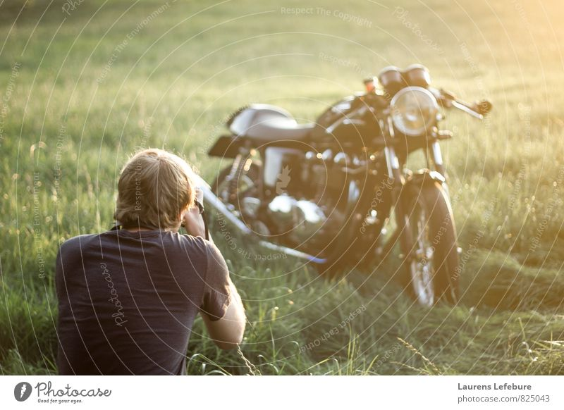 Young man observing Triumph thruxton motorcycle in the field. Green Beautiful Eroticism Style Lifestyle Orange Dream Leisure and hobbies Elegant Success