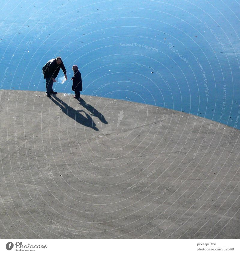 ice-cold games Lake Ice-cream vender Thorough Splashing Concrete Hard Round Platform Father Daughter Child Stand Shadow Curved Delicious Ice floe Body of water