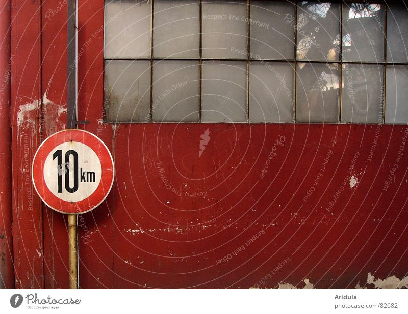 Tree Red Street Wall (building) Window Lanes & trails Glass Signs and labeling Transport Speed Circle Safety To go for a walk Digits and numbers Derelict