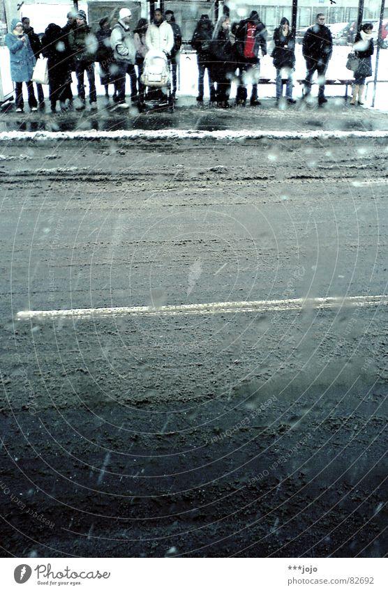 Human being Blue City Winter Street Cold Snow Gray Wait Wet Transport Gloomy Multiple Freeze Bavaria Mud