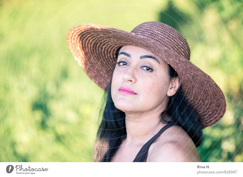 Portrait in the green Woman Adults 1 Human being 30 - 45 years Nature Summer Beautiful weather Hat Black-haired Long-haired Sadness Dreamily Absentminded