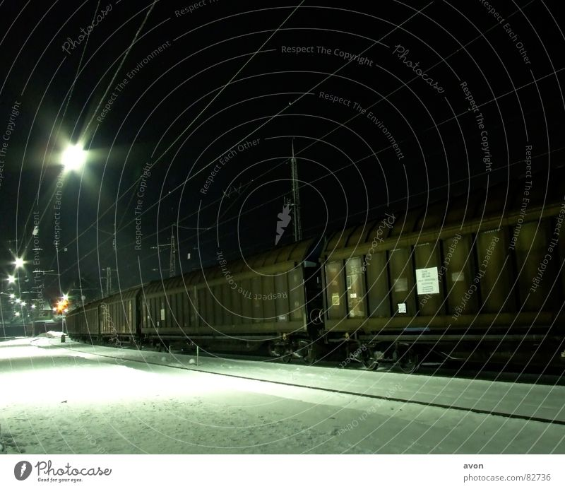 Lonely cargo Railroad Railroad tracks Night Station Train station express train special train Snow wagon containers Cable