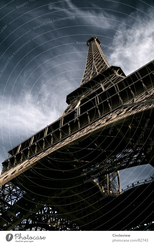 No fear of heights Paris Clouds Steel Landmark Art Dark Exciting Alarming Eerie Moody Tourist Tourism Worm's-eye view Night Eiffel Tower Flair Threat Creepy
