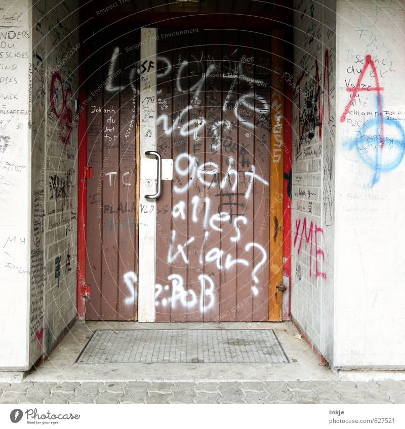 must be yes. Lifestyle Leisure and hobbies Graffiti Deserted Building Wall (barrier) Wall (building) Door Front door Entrance Gymnasium Sign Characters