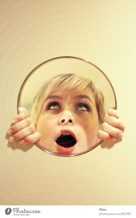 Woman Joy Wall (building) Blonde Glass Circle Image Mirror Reflection Surprise Amazed Frightening Marvel