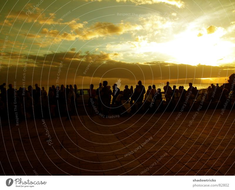 Human being Sky Water Green Red Sun Ocean Beach Clouds Yellow Coast Sit Island Society Audience Africa