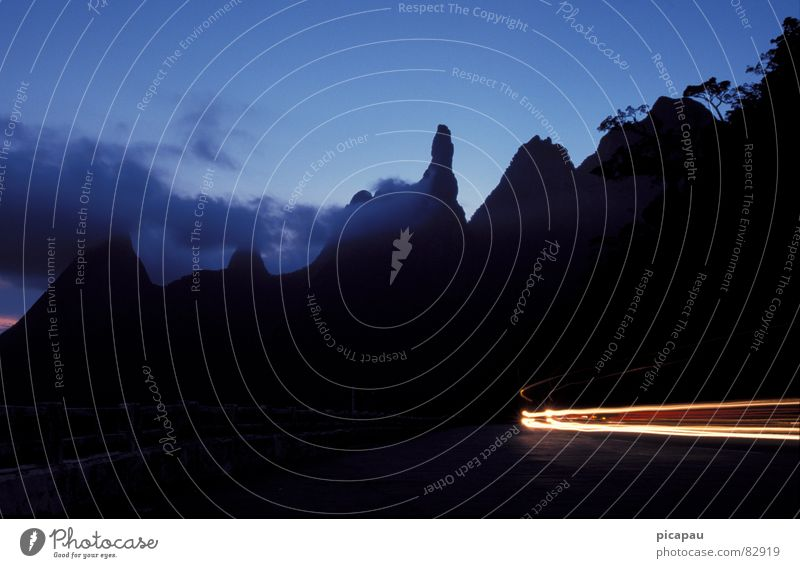 Blue Black Clouds Mountain Illuminate Virgin forest Curve Dusk Floodlight Car headlights Mountain range Flare Tracer path Beam of light Light streak