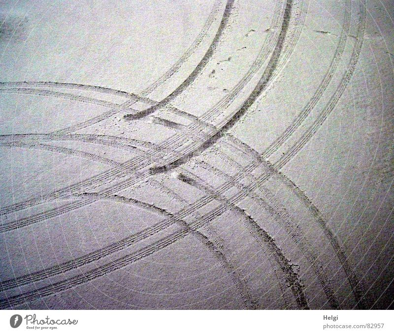Tire tracks in the snow from a bird's eye view Colour photo Subdued colour Exterior shot Detail Pattern Deserted Twilight Shadow Bird's-eye view Winter Snow Ice