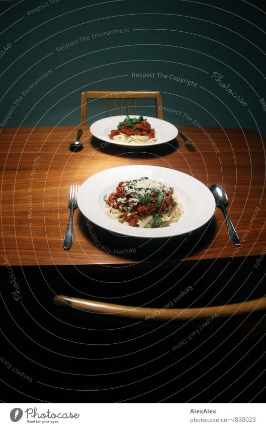 Two Bolognese, one without cheese! Spaghetti Basil Noodles Dinner table Chair Cheese Parmesan Italian Food Crockery Plate Cutlery Fork Spoon Wood Eating