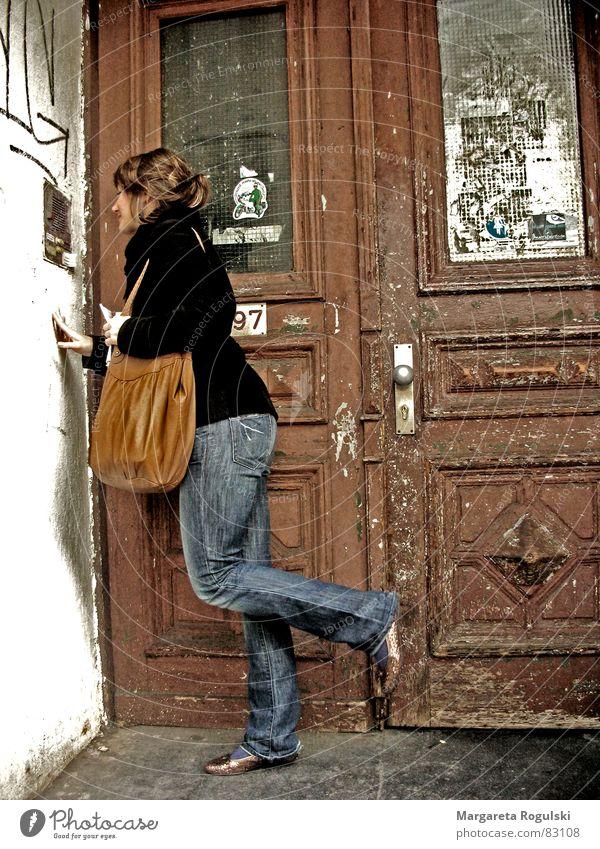in front of locked doors Cold Broken Bag Block House (Residential Structure) East Wood Wooden door Guest Door handle Entrance Intercom system Old town