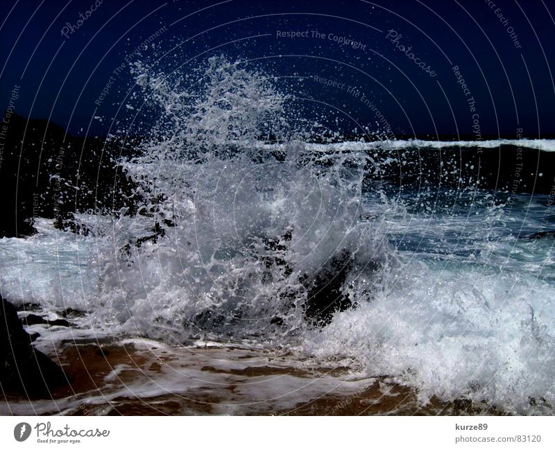 Perfect wave Waves Beach Ocean Vacation & Travel Surf Gale Drops of water Sea water Summer Sandy beach Wet Sardinia Water Blue Stone Wind Salt Sky Rock