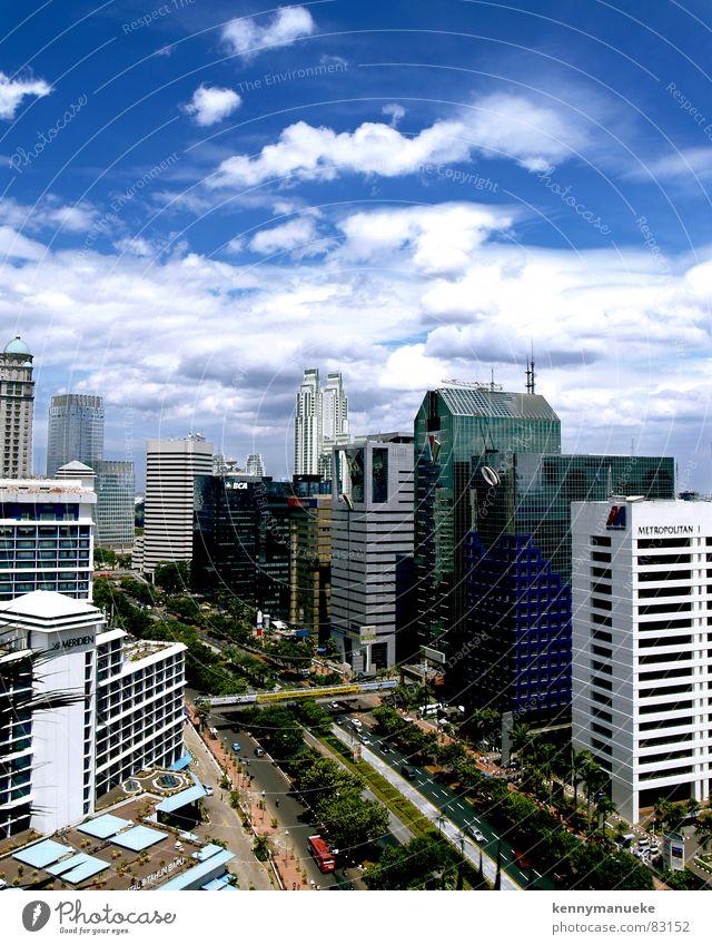 Jakarta's Scrapers Jacarta Town capital city indonesia buildings main road clouds noon office buildings