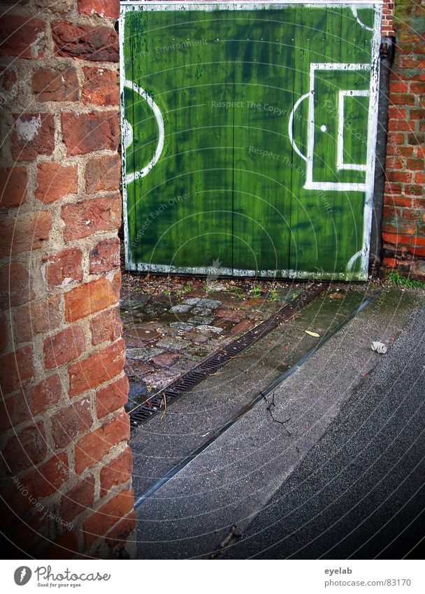 Goal, goal, soccer goal! Goalkeeper Excessive zeal Green Highway ramp (entrance) Entrance Way out Brick Wall (building) Real estate Wood Wooden gate