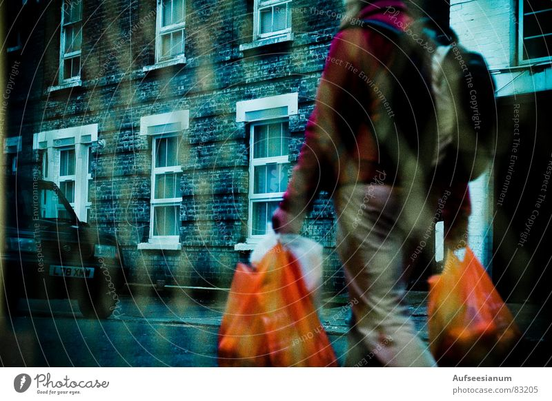 basement Shopping Window Street life Human being Grating Vantage point Colour bags Looking Contrast Orange view melancholic