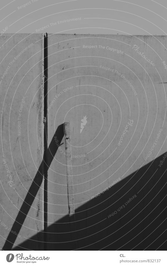 the order of things Construction site Wall (barrier) Wall (building) Build Gloomy Wooden board Traces of fomer wall Black & white photo Exterior shot Abstract