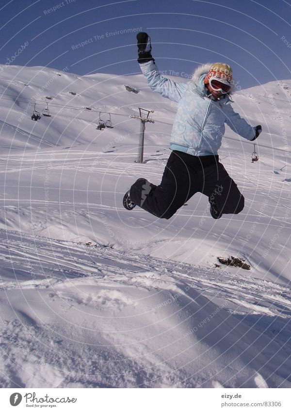 Woman Joy Mountain Snow Style Jump Tall To enjoy Posture Austria Snowscape Blue sky Joke Winter sports Ski lift Ski run