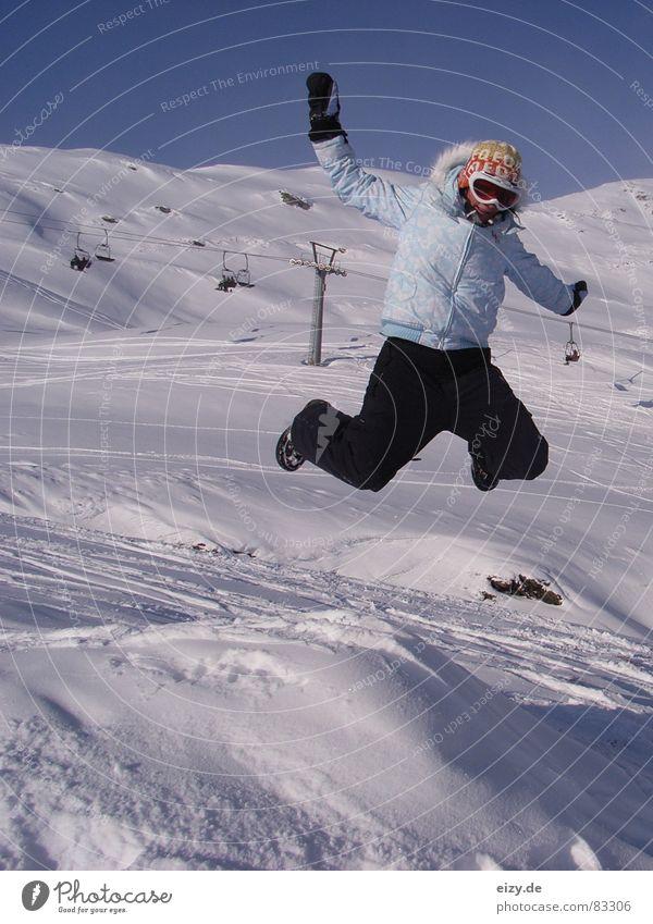 Woman Joy Mountain Snow Style Jump Tall To enjoy Posture Austria Snowscape Blue sky Joke Winter sports Ski lift Ski run