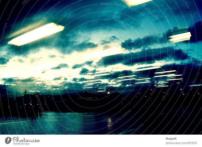 double reflection Seattle sun ferry window lights blue water
