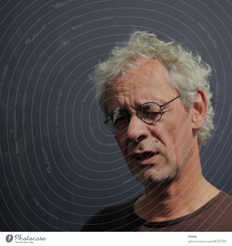 Self. Masculine 1 Human being Wall (barrier) Wall (building) T-shirt Eyeglasses Gray-haired Short-haired Observe Think Looking Wait Watchfulness Caution Serene