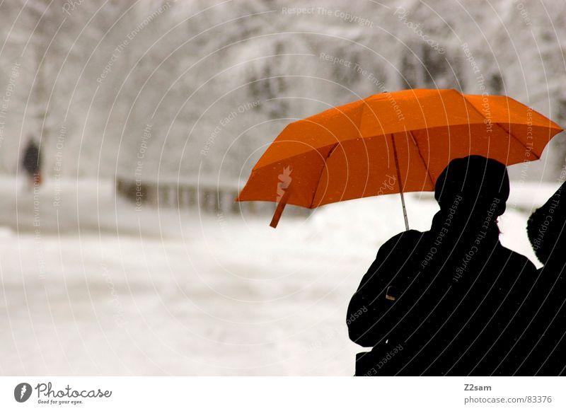 Human being Street Snow Gray Couple Lanes & trails 2 Orange Going Gloomy Umbrella To go for a walk Precipitation Winter walk