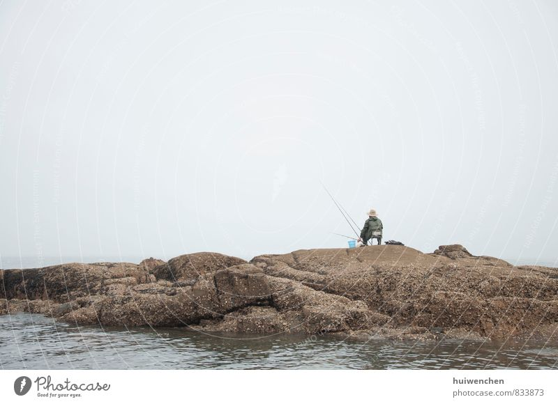 the fisherman, alone Human being Masculine Man Adults 1 45 - 60 years Nature Water Fog Coast Ocean Lake Stone Sit Serene Calm Fishing (Angle) Colour photo
