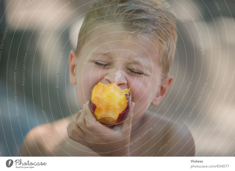 Vitamins :-) Child Brother Infancy Youth (Young adults) Head 8 - 13 years Eating Healthy Delicious Juicy Peach more gourmet Portrait photograph Closed eyes